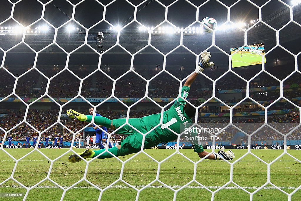 Keylor Navas of Costa Rica saves a penalty kick by Theofanis Gekas of Greece in a penalty shootout during the 2014 FIFA World Cup Brazil Round of 16 match between Costa Rica and Greece at Arena Pernambuco on June 29, 2014 in Recife, Brazil.