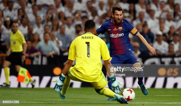 Keylor Navas of Real Madrid and Lionel Messi of Barcelona battle for the ball during the Supercopa de Espana Supercopa Final 2nd Leg match between...