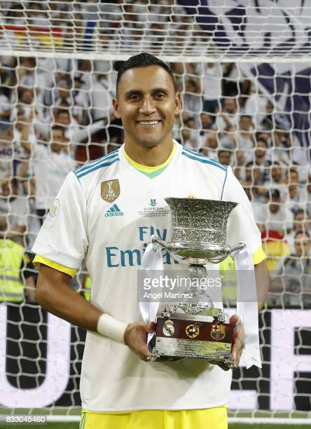 Keylor Navas of Real Madrid celebrates with the trophy after the Supercopa de Espana Final second leg match between Real Madrid and FC Barcelona at...