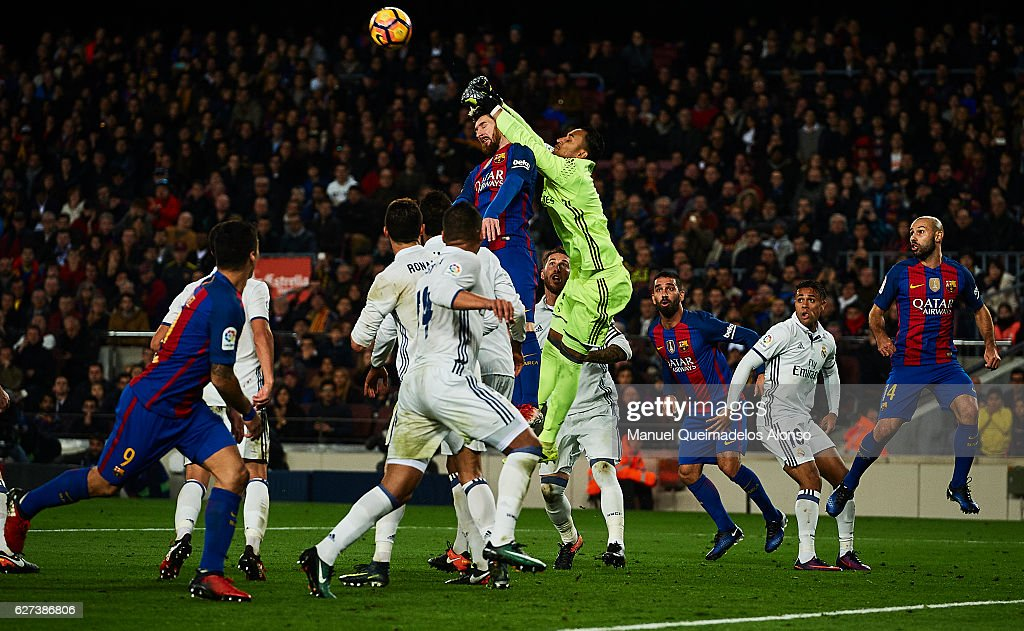 Keylor Navas of Real Madrid CF block a shoot of Lionel Messi of FC Barcelona during La Liga match between FC Barcelona and Real Madrid CF at Camp Nou...