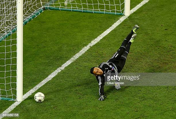 Keylor Navas of Real Madrid dives as the penalty kicked by Juanfran of Atletico Madrid hits the post during the UEFA Champions League Final match...