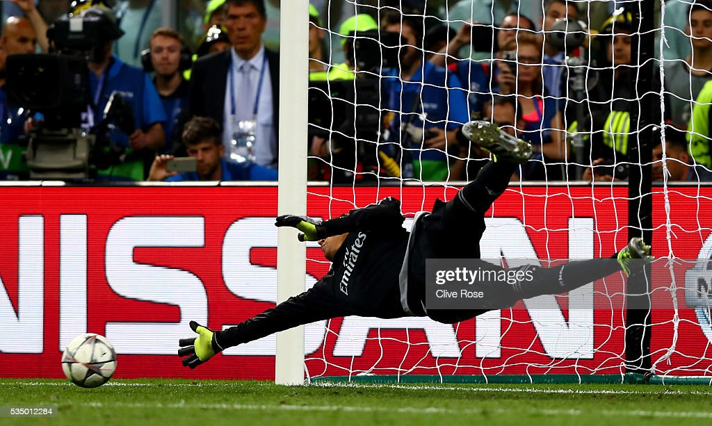 <a gi-track='captionPersonalityLinkClicked' href=/galleries/search?phrase=Keylor+Navas&family=editorial&specificpeople=2097517 ng-click='$event.stopPropagation()'>Keylor Navas</a> of Real Madrid dives as the penalty kicked by Juanfran of Atletico Madrid hits the post during the UEFA Champions League Final match between Real Madrid and Club Atletico de Madrid at Stadio Giuseppe Meazza on May 28, 2016 in Milan, Italy.