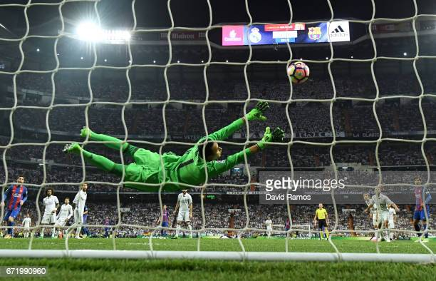 Keylor Navas of Real Madrid fails to stop Ivan Rakitic of Barcelona from scoring their second goal during the La Liga match between Real Madrid CF...