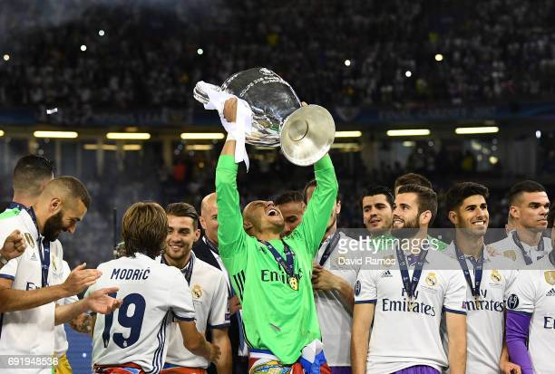 Keylor Navas of Real Madrid lifts The Champions League trophy after the UEFA Champions League Final between Juventus and Real Madrid at National...