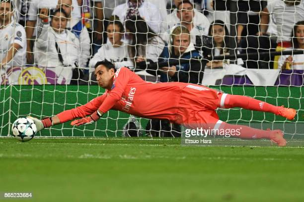Keylor Navas of Real Madrid makes a save during the UEFA Champions League group H match between Real Madrid and Tottenham Hotspur at Estadio Santiago...