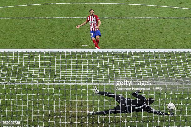Keylor Navas of Real Madrid safes the penalty by Juanfran of Atletico Madrid during the UEFA Champions League Final between Real Madrid and Club...