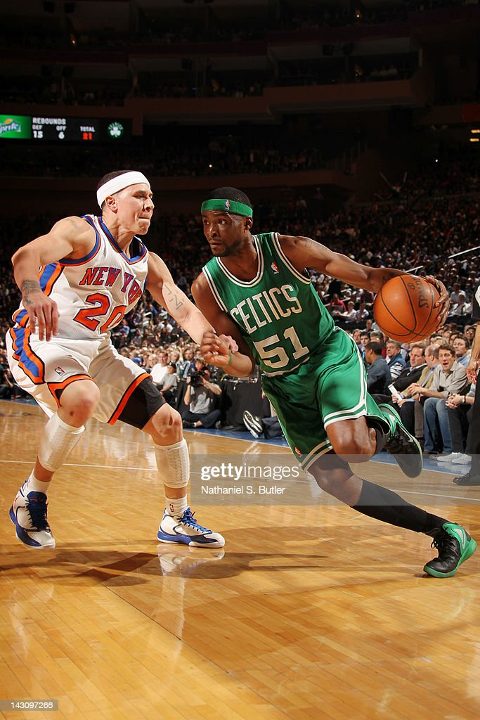 Keyon Dooling #51 of the Boston Celtics drives to the basket against Mike Bibby #20 of the New York Knicks during the game on April 17, 2012 at Madison Square Garden in New York City.