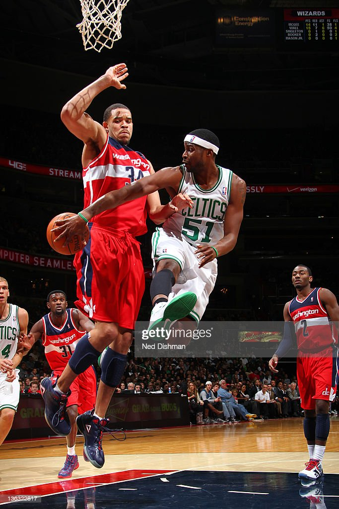 <a gi-track='captionPersonalityLinkClicked' href=/galleries/search?phrase=Keyon+Dooling&family=editorial&specificpeople=202647 ng-click='$event.stopPropagation()'>Keyon Dooling</a> #51 of the Boston Celtics passes against <a gi-track='captionPersonalityLinkClicked' href=/galleries/search?phrase=JaVale+McGee&family=editorial&specificpeople=4195625 ng-click='$event.stopPropagation()'>JaVale McGee</a> #34 of the Washington Wizards during the game at the Verizon Center on January 1, 2012 in Washington, DC.