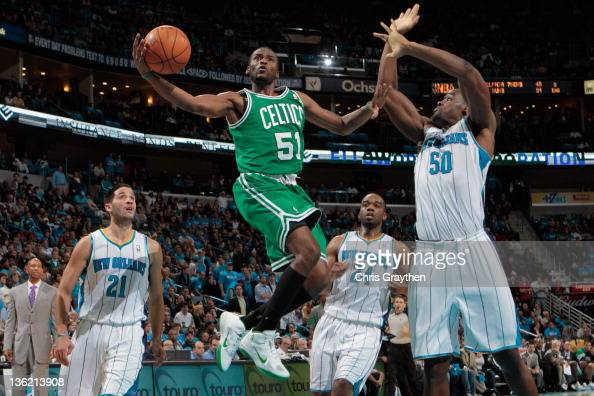 Keyon Dooling of the Boston Celtics shoots the ball over Emeka Okafor of the New Orleans Hornets at New Orleans Arena on December 28 2011 in New...