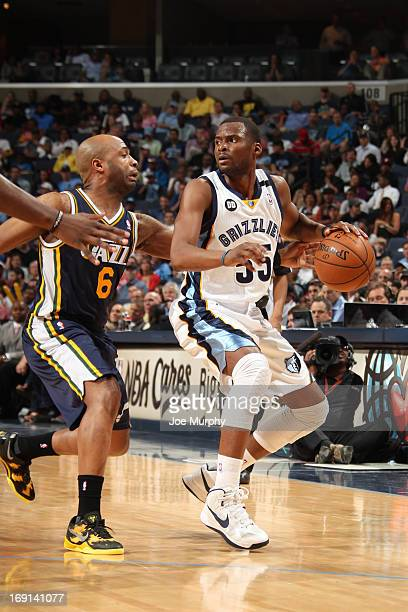 Keyon Dooling of the Memphis Grizzlies drives against Jamaal Tinsley of the Utah Jazz on April 17 2013 at FedExForum in Memphis Tennessee NOTE TO...