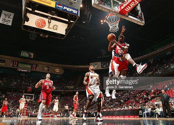 Keyon Dooling of the New Jersey Nets passes against Corey Maggette of the Golden State Warriors on November 1 2008 at the Izod Center in East...
