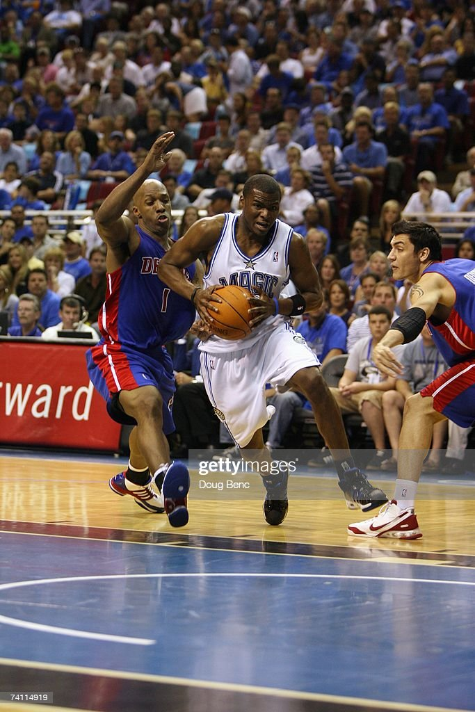 Keyon Dooling #5 of the Orlando Magic drives to the basket against Chauncey Billups #1 and Carlos Delfino #20 of the Detroit Pistons in Game Four of the Eastern Conference Quarterfinals during the 2007 NBA Playoffs at Amway Arena on April 28, 2007 in Orlando, Florida. The Pistons won 97-93 and won the series 4-0.