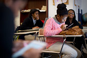 Keyona Duncan took a quiz during a financial literacy workshop Carol Smolinsky the program manager at 'Invest in Girls' taught a workshop for...