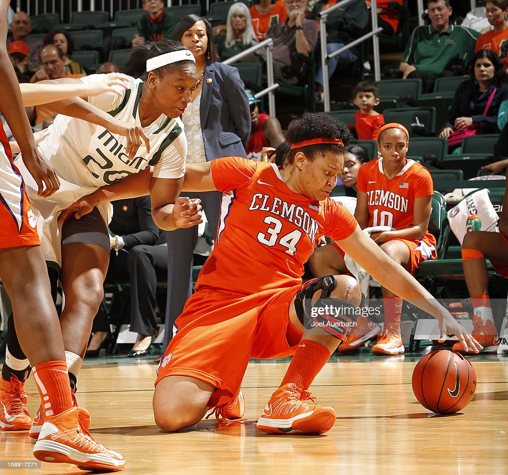 Keyona Hayes #20 of the Miami Hurricanes and Natiece Ford #34 of the Clemson Lady Tigers go after a loose ball on January 3, 2013 at the BankUnited Center in Coral Gables, Florida.