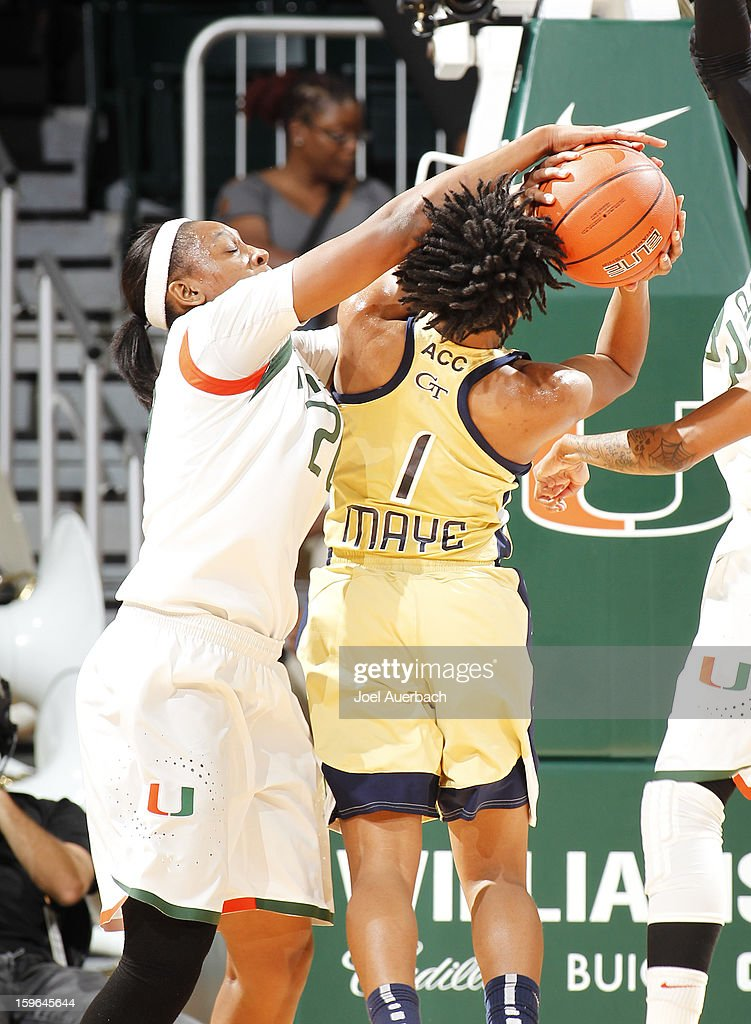 Keyona Hayes #20 of the Miami Hurricanes blocks the shot by Dawnn Maye #1 of the Georgia Tech Yellow Jackets on January 17, 2013 at the BankUnited Center in Coral Gables, Florida.