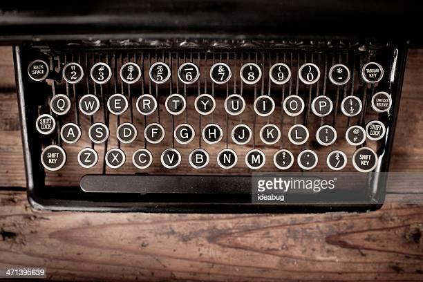 Keys of Vintage, Black, Manual Typewriter on Wood Trunk