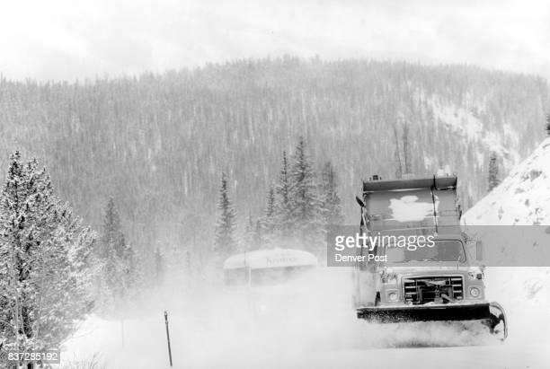 A keystone bus follows a snowplow up Loveland Pass Credit The Denver Post