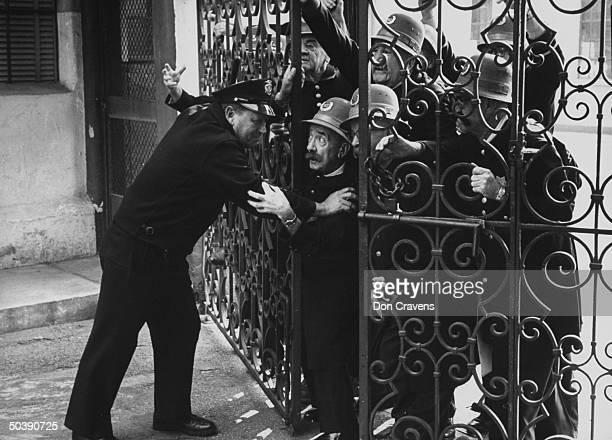 Keystone Cops reenacting old slapstick routine during reunion