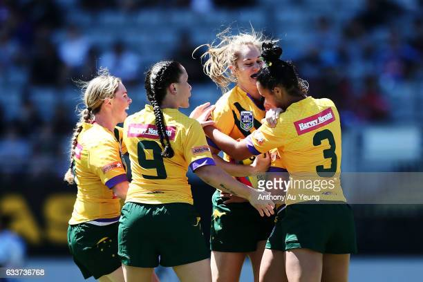 Kezie Apps of the Australian Jillaroos celebrates with teammates after scoring a try during the 2017 Auckland Nines match between the Kiwi Ferns and...