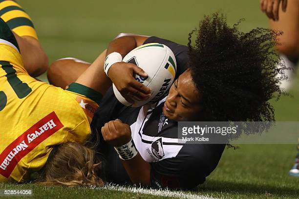 Kezie Apps of the Kiwi Ferns is tackled during the Women's international Rugby League Test match between the Australian Jillaroos and New Zealand...
