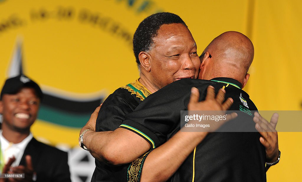 Kgalema Motlanthe is embraced by Jacob Zuma after giving his last speech as deputy president of the ANC on Day 3 of the ANC Conference which saw Jacob Zuma re-elected as ANC President on December 17, 2012, in Bloemfontein, South Africa. Cyril Ramaphosa was elected Deputy President, Gwede Mantashe Secretary General and Jesse Duarte as Deputy Secretary General.