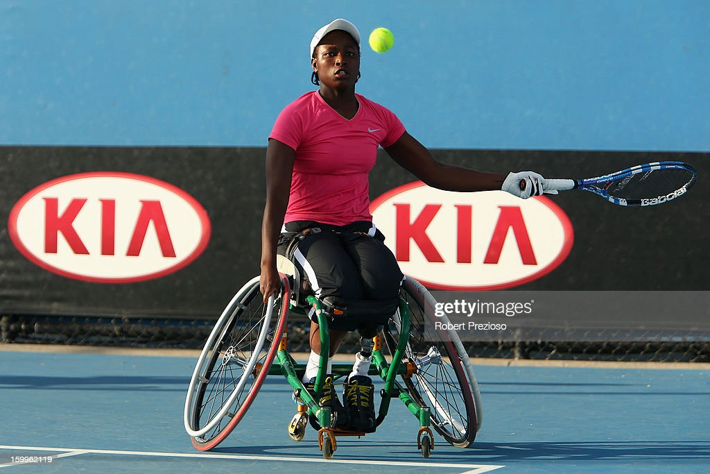 Kgothatso Montjane of South Africa plays a forehand in her Women's Wheelchair Doubles Semifinal match with Daniela Di Toro of Australia against Aniek Van Koot and Jiske Griffioen of the Netherlands during the 2013 Australian Open Wheelchair Championships at Melbourne Park on January 24, 2013 in Melbourne, Australia.