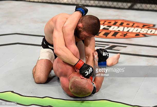Khabib Nurmagomedov punches Darrell Horcher in their lightweight bout during the UFC Fight Night event at Amalie Arena on April 16 2016 in Tampa...