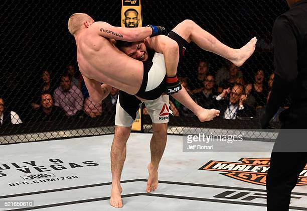 Khabib Nurmagomedov takes down Darrell Horcher in their lightweight bout during the UFC Fight Night event at Amalie Arena on April 16 2016 in Tampa...