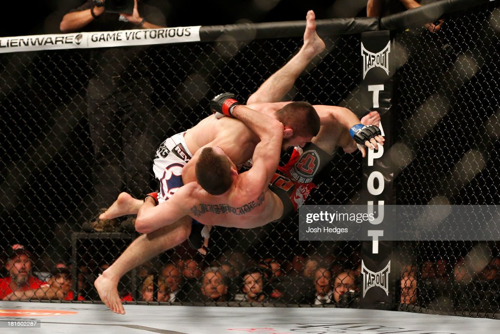 Khabib Nurmagomedov takes down Pat Healy in their UFC lightweight bout at the Air Canada Center on September 21, 2013 in Toronto, Ontario, Canada.