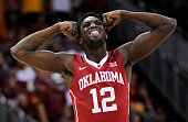 Khadeem Lattin of the Oklahoma Sooners celebrates after teammate Ryan Spangler dunked in the first half against the Iowa State Cyclones during a...