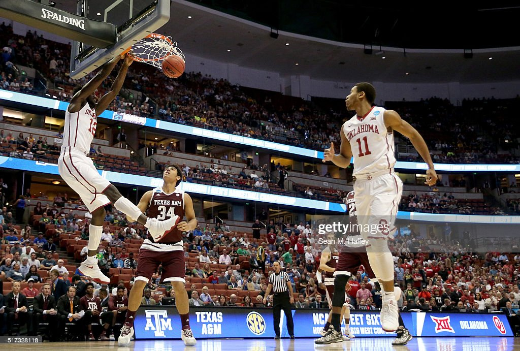 Khadeem Lattin of the Oklahoma Sooners dunks the ball against Tyler Davis of the Texas AM Aggies in the first half in the 2016 NCAA Men's Basketball...