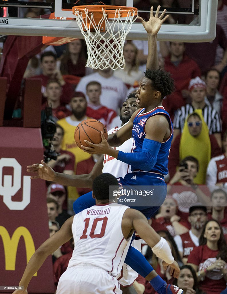Khadeem Lattin #12 of the Oklahoma Sooners forces Devonte' Graham #4 of the Kansas Jayhawks to pass the ball during the second half of a NCAA college basketball game at the Lloyd Noble Center on February 13, 2016 in Norman, Oklahoma. Kansas won 76-72.