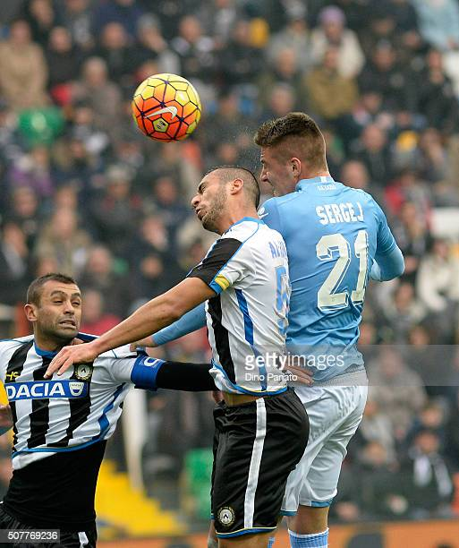 Khadim Ali Adnan of Udinese Calcio battles for an aerial ball with Sergej Milinkovic of SS Lazio during the Serie A match between Udinese Calcio and...