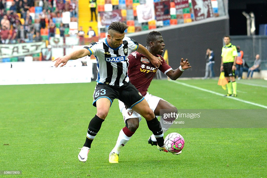 Khadim Ali Adnan (L) of Udinese Calcio competes with Afriye Acquah of Torino FC during the Serie A match between Udinese Calcio and Torino FC at Dacia Arena on April 30, 2016 in Udine, Italy.