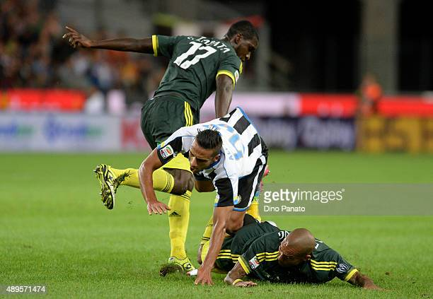 Khadim Ali Adnan of Udinese Calcio is challenged by Cristian Zapata and Nigel De Jong of AC Milan during the Serie A match between Udinese Calcio and...