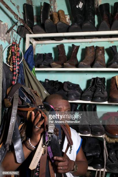 Khaditoza Gola the leader of the Leopard Sapeur shows his big clothing collection in his home on February 12 2017 in Kinshasa DRC The word Sapeur...