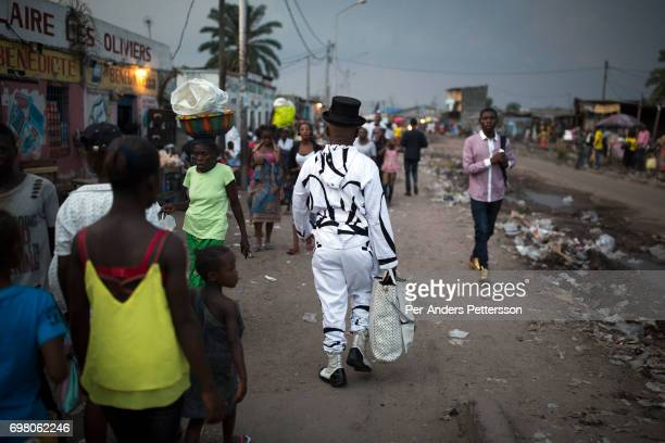 Khaditoza Gola the leader of the Leopard Sapeurs walks on the street close to his home on February 12 2017 in Kinshasa DRC The word Sapeur comes from...