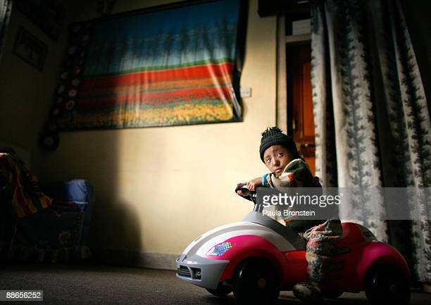 Khagendra Thapa Magar 15 and a half sits on his toy car at home on March 12 2007 in Pokhara Nepal According to the Guinness World Book of Records...