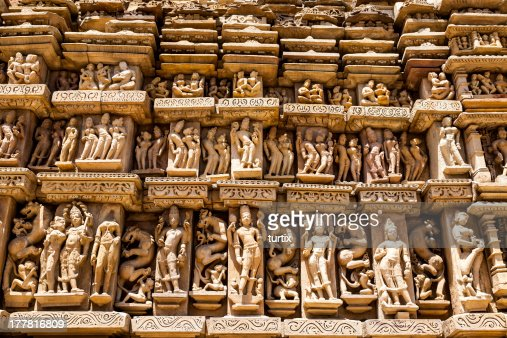 Khajuraho stone carved temple with erotic sculptures