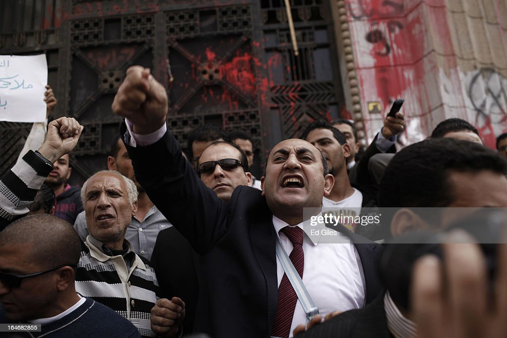 Khaled Ali, former Egyptian Presidential candidate, chants during a protest against the summons of five high profile activists at the High Court on March 26, 2013 in Cairo, Egypt. Five high profile Egyptian activists were summoned by the Egyptian Prosecutor General's office on charges of inciting violent clashes between opposition protesters and supporters of the Muslim Brotherhood in the Cairo suburb of Muqattam on March 22. Those charged include renowned blogger Alaa Abdel Fattah, Popular Current member Ahmed Doma, National Salvation Front member Hazem Abdel-Azim, Constitution Party member Ahmed Eid, activist Karim El-Shaer, and journalist and blogger Nawara Negm.