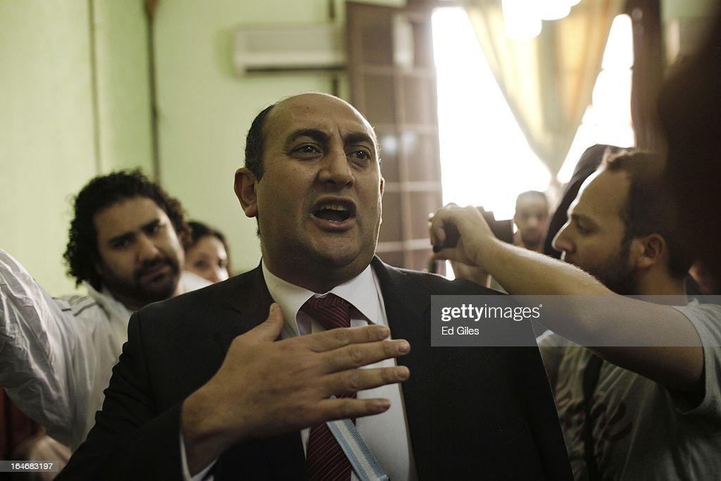 Khaled Ali (C), former Egyptian Presidential candidate, speaks to the media beside blogger and activist Alaa Abdel Fattah (L) prior to a hearing at the Cairo High Court on March 26, 2013 in Cairo, Egypt. Five high profile Egyptian activists were summoned by the Egyptian Prosecutor General's office on charges of inciting violent clashes between opposition protesters and supporters of the Muslim Brotherhood in the Cairo suburb of Muqattam on March 22. Those charged include renowned blogger Alaa Abdel Fattah, Popular Current member Ahmed Doma, National Salvation Front member Hazem Abdel-Azim, Constitution Party member Ahmed Eid, activist Karim El-Shaer, and journalist and blogger Nawara Negm.