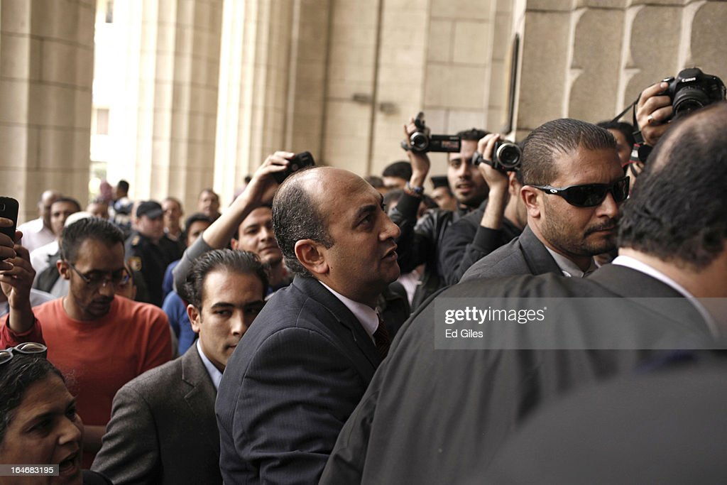 Khaled Ali (C), former Egyptian Presidential candidate, walks up the stairs to the Cairo High Court prior to a hearing for five high profile activists on March 26, 2013 in Cairo, Egypt. Five high profile Egyptian activists were summoned by the Egyptian Prosecutor General's office on charges of inciting violent clashes between opposition protesters and supporters of the Muslim Brotherhood in the Cairo suburb of Muqattam on March 22. Those charged include renowned blogger Alaa Abdel Fattah, Popular Current member Ahmed Doma, National Salvation Front member Hazem Abdel-Azim, Constitution Party member Ahmed Eid, activist Karim El-Shaer, and journalist and blogger Nawara Negm.