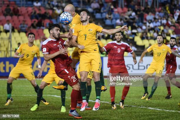 Khaled Almbayed of Syria and Mathew Leckie of Australia fight for the ball during the 2018 World Cup qualifying football match between Syria and...