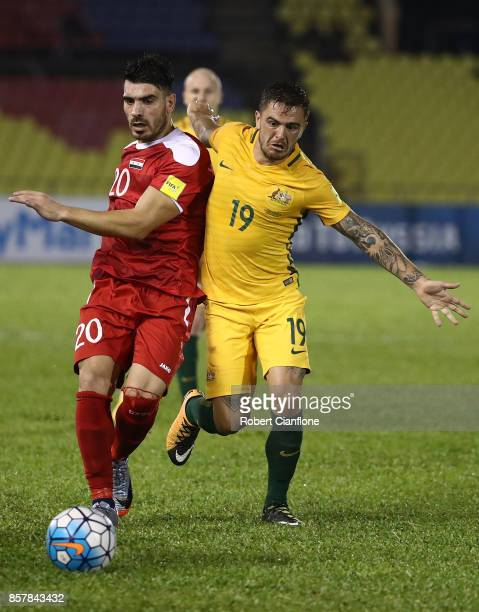 Khaled Almbayed of Syria challenges Josh Risdon of Australia during the 2018 FIFA World Cup Asian Playoff match between Syria and the Australia...