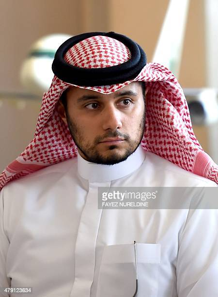Khaled Alwaleed bin Talal the son of Saudi Arabia's billionaire Prince Alwaleed bin Talal looks on as his father speaks during a press conference in...