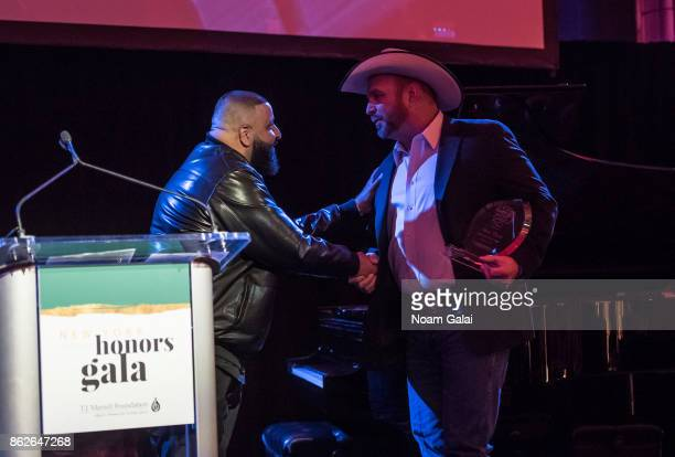 DJ Khaled and Garth Brooks attend the TJ Martell 42nd Annual New York Honors Gala at Guastavino's on October 17 2017 in New York City