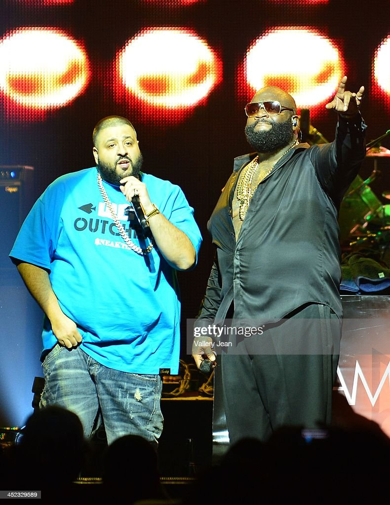 DJ Khaled and Rick Ross perform at James L Knight Center on November 23, 2013 in Miami, Florida.
