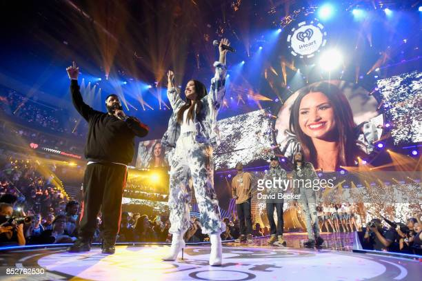 DJ Khaled Demi Lovato Travis Scott Chance The Rapper and Quavo perform onstage during the 2017 iHeartRadio Music Festival at TMobile Arena on...