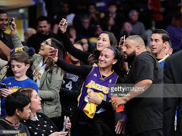 Khaled takes a selfie with a fan at a basketball game between the Golden State Warriors and the Los Angeles Lakers at Staples Center on January 5...