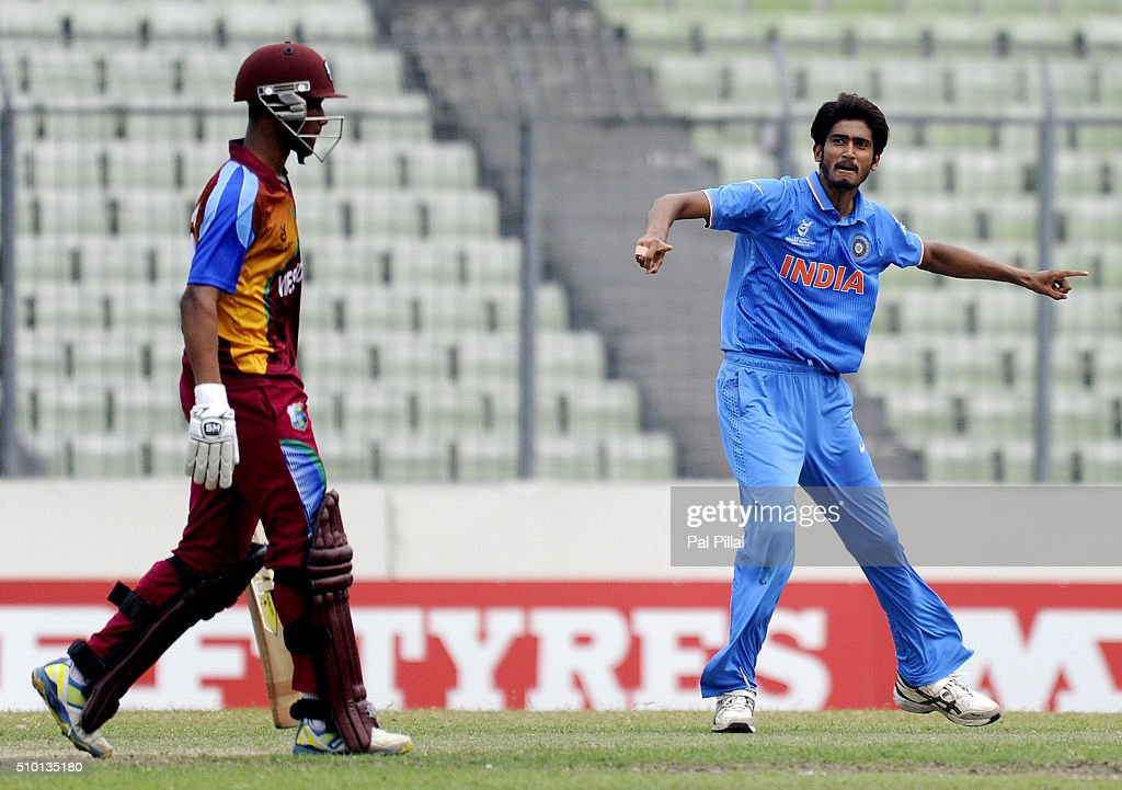 Khaleel Ahmed of India celebrates the wicket of Tevin Imlach of West Indies U19 as the latter walks back after getting out during the ICC U19 World Cup Final Match between India and West Indies on February 14, 2016 in Dhaka, Bangladesh.